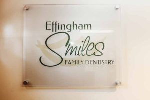 Effingham Smiles Family Dentistry insurance page with logo